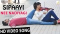 Nee Nadhiyaagi Song Lyrics